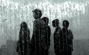 People Standing In The Rain